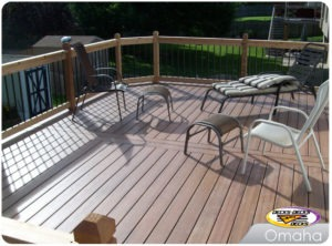 A low maintenance deck with patio chairs