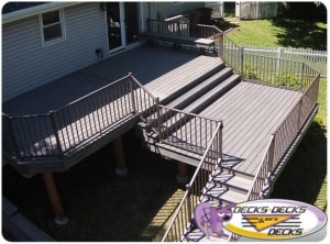 An aerial view of a second story deck with stairs to the lawn