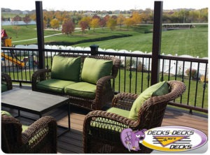 A low maintenance second story deck with patio furniture