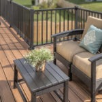 Patio furniture on a second story low maintenance deck
