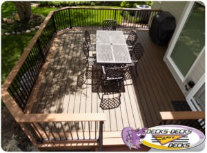 A custom low maintainence deck with drink rails.